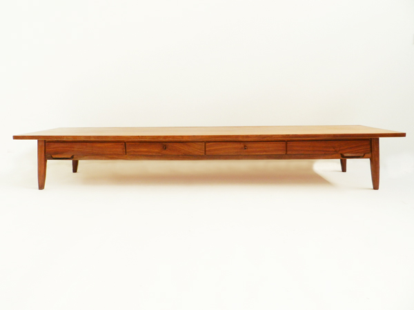 Long low banquette with drawers