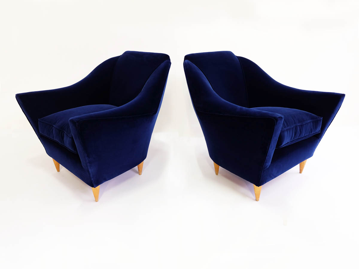 Pair of deep blue velvet Manta armchairs