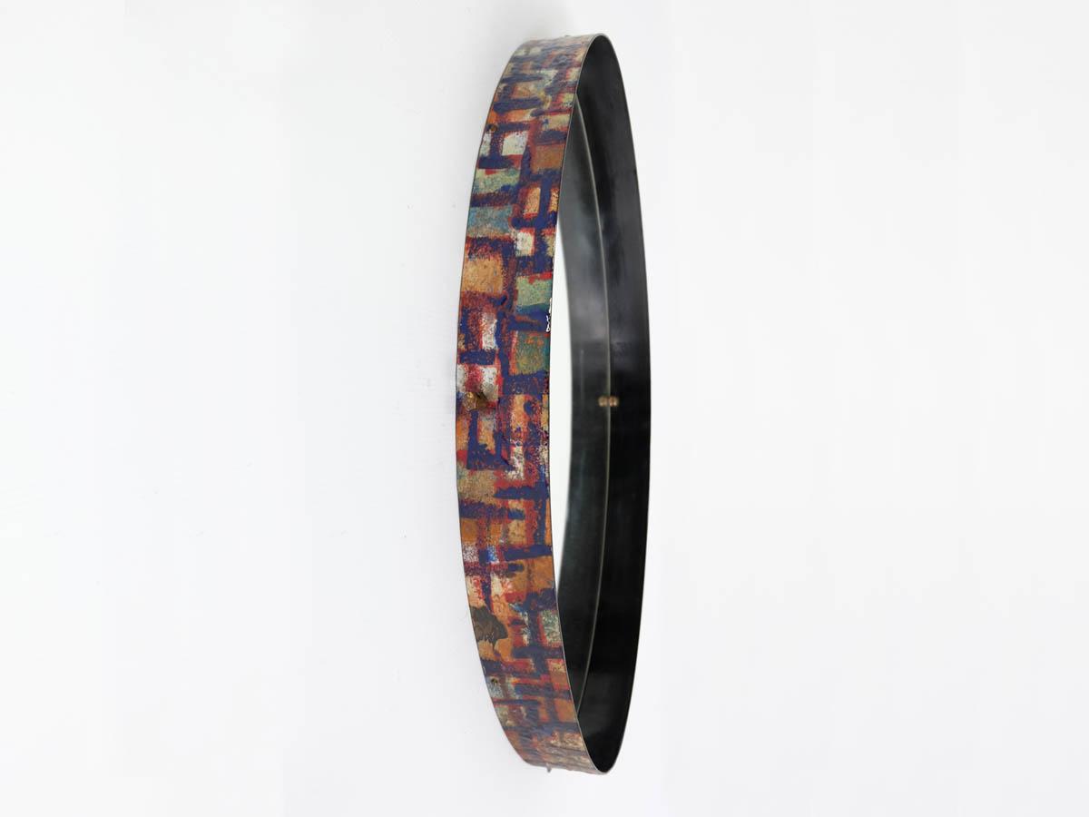 Colored mirror in enameled metal