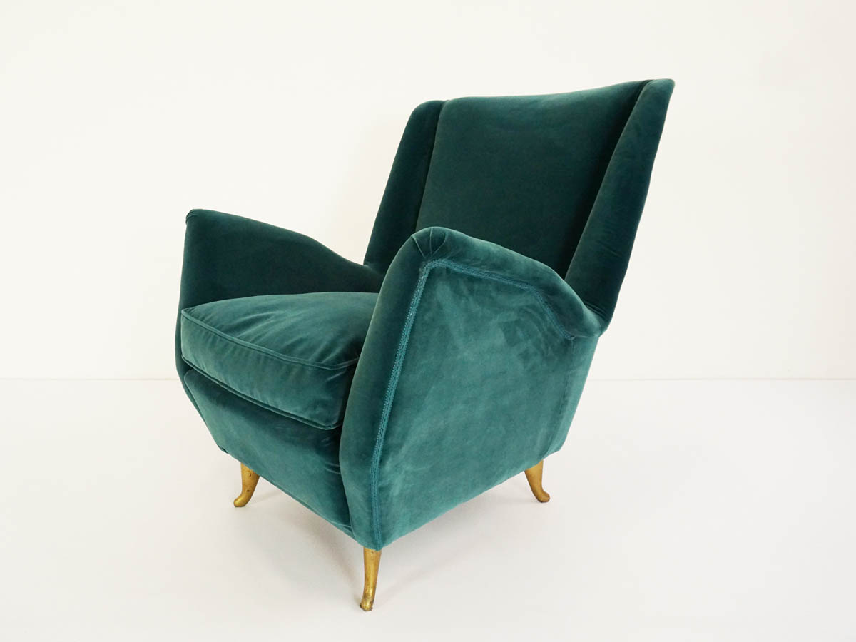 Deep green velvet cozy armchair
