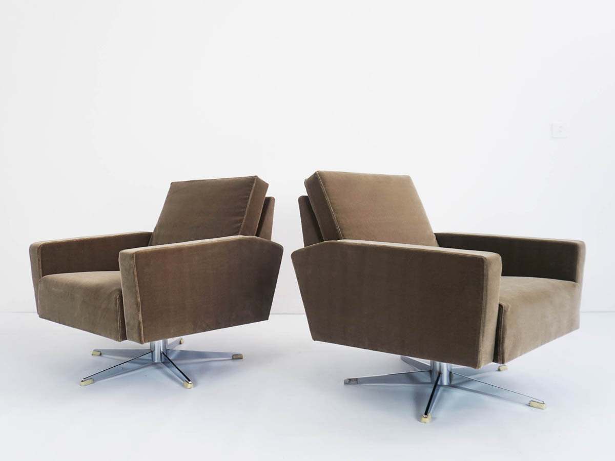 Revolving modern armchairs and curved sofa