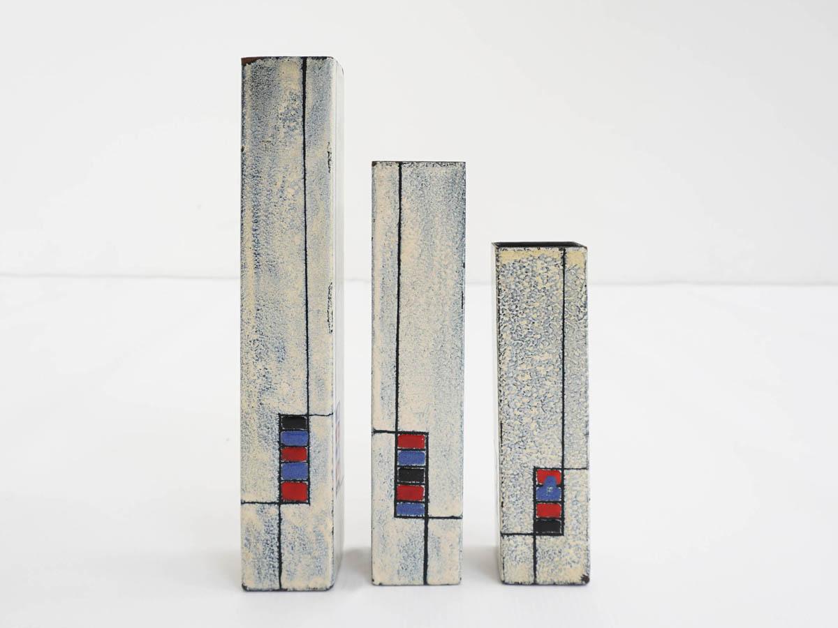 Enameled metal vases