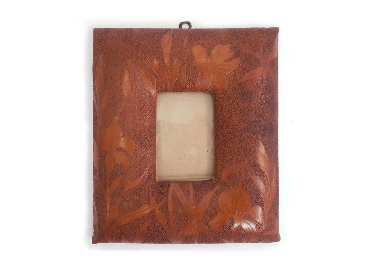 Flowers textured leather swollen frame
