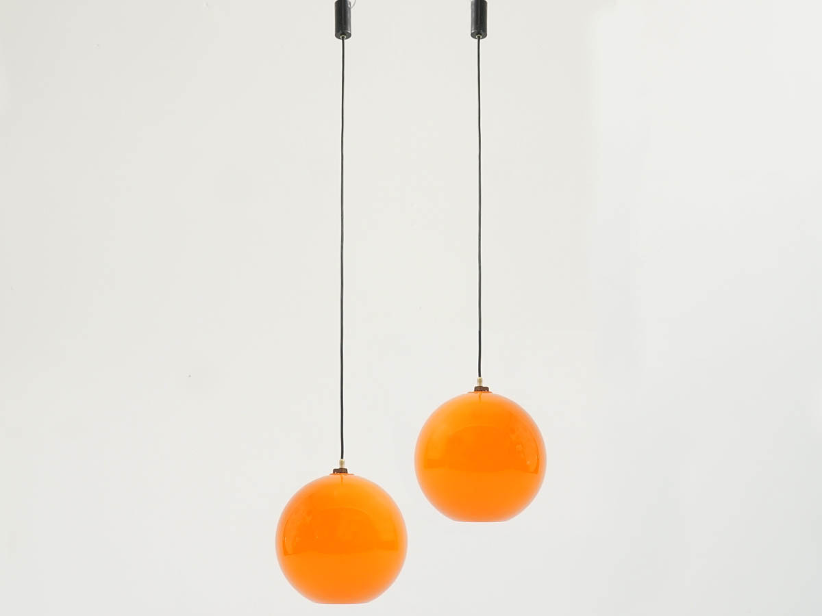 Pair of Orange Power Ball hanging light